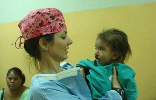 Dr. Walden with her patient with a bilateral cleft lip.
